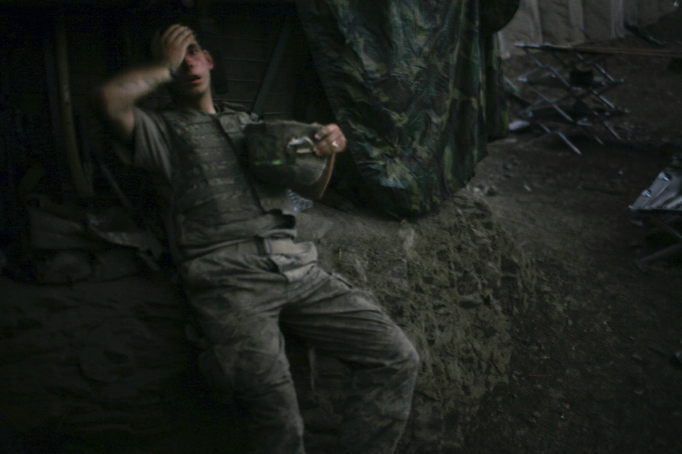 World Press Photo of the Year 2007 by Tim Hetherington shows an exhausted soldier in Afghanistan.